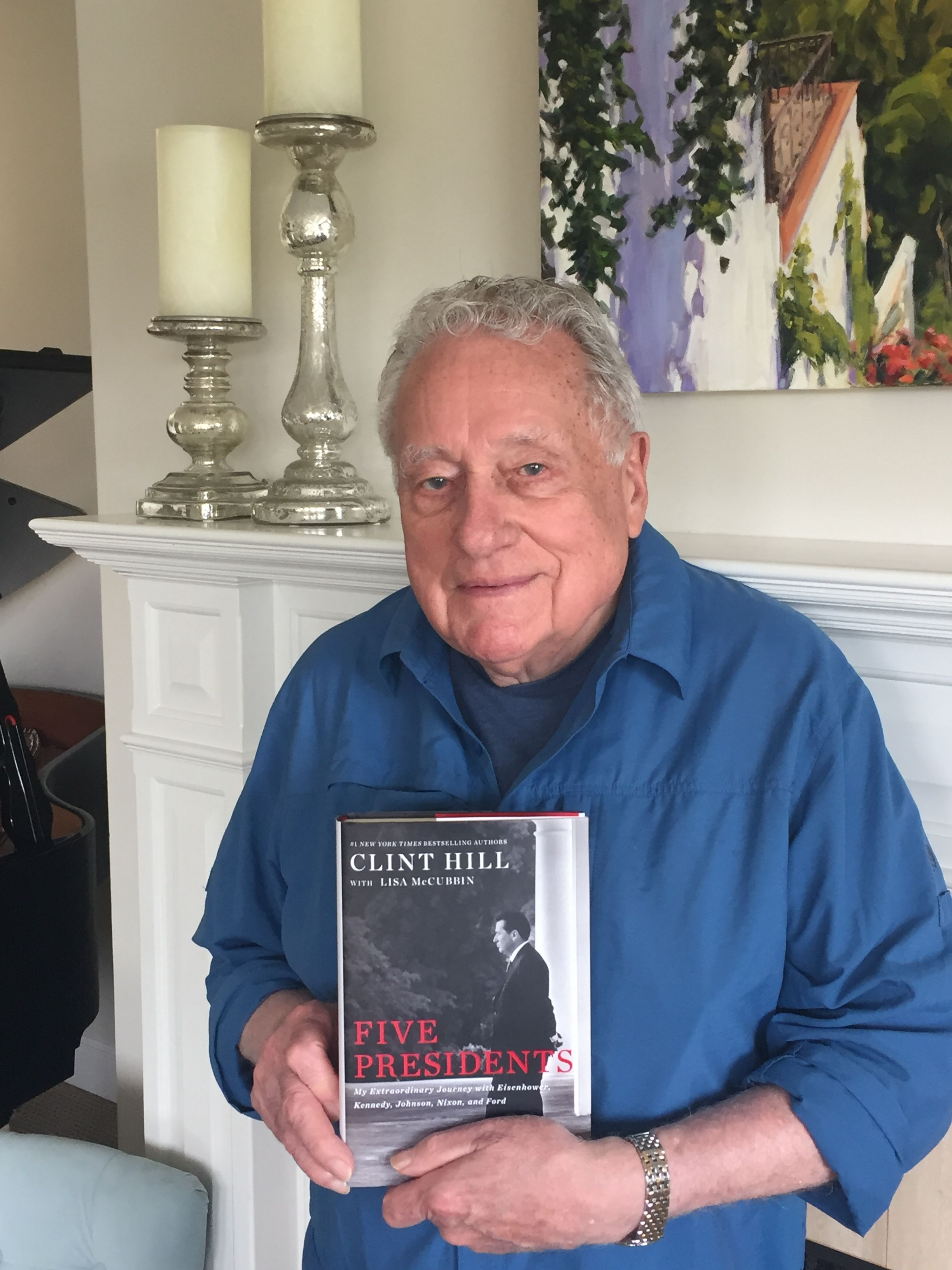 Secret Service Agent Clint Hill holds first edition of his