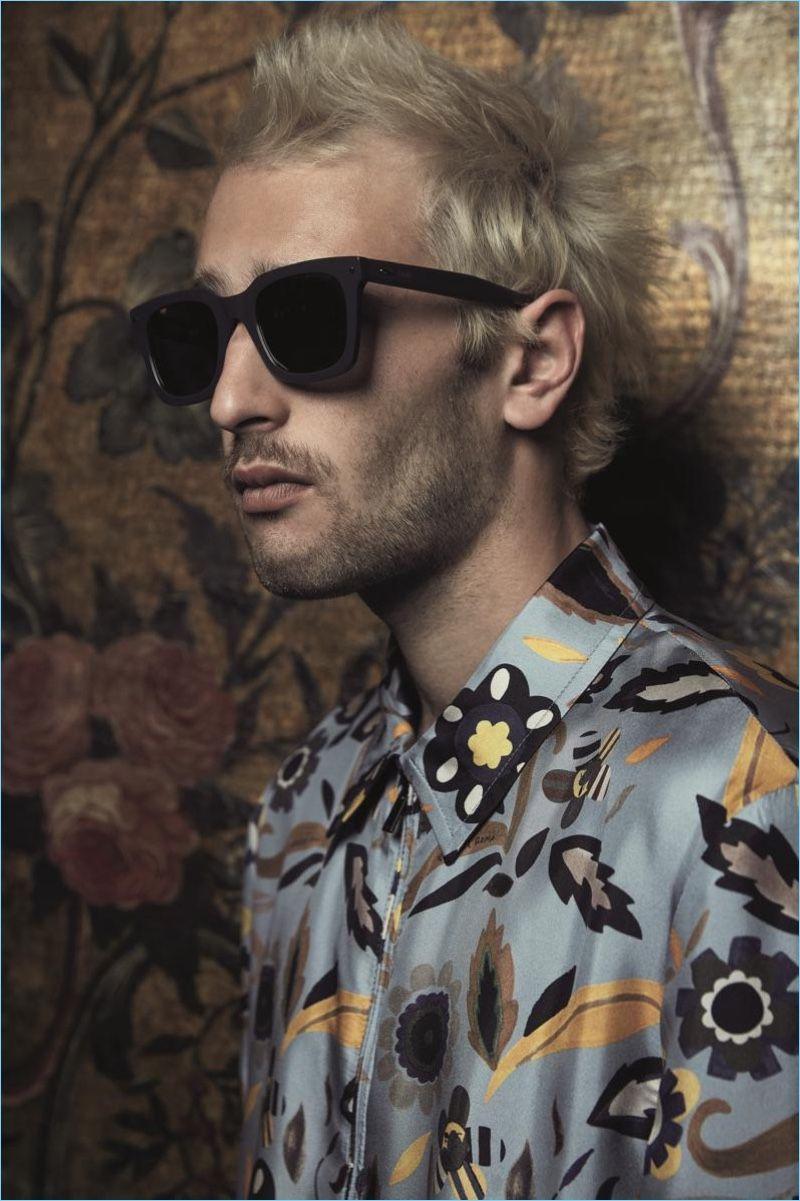 f15d4a74f1a7 Front and center, Hopper Penn wears Fendi Sun Fun Black Asian fit sunglasses  $325 and a Fendi printed light blue silk jacket $2,200.