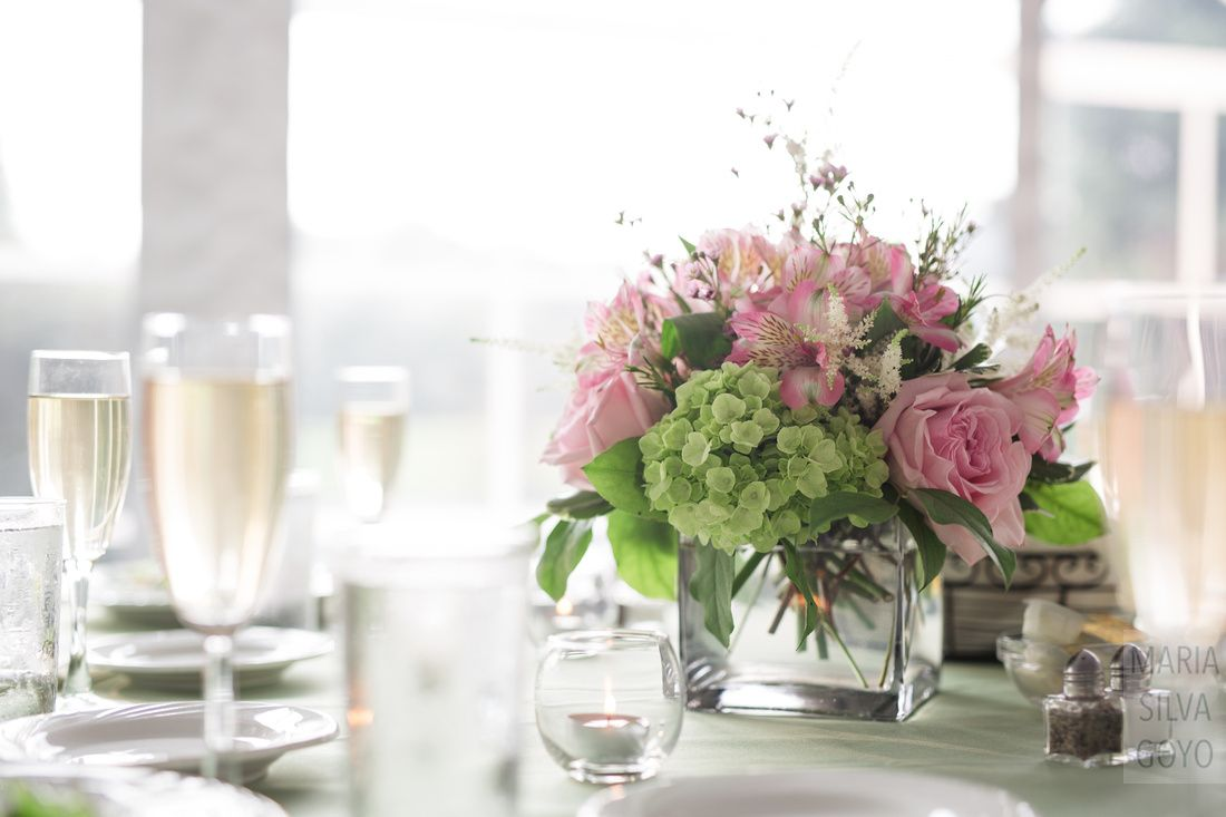 Pale green and pink flower center piece by Hendrick's Flowers for wedding reception at the Cornwall Inn