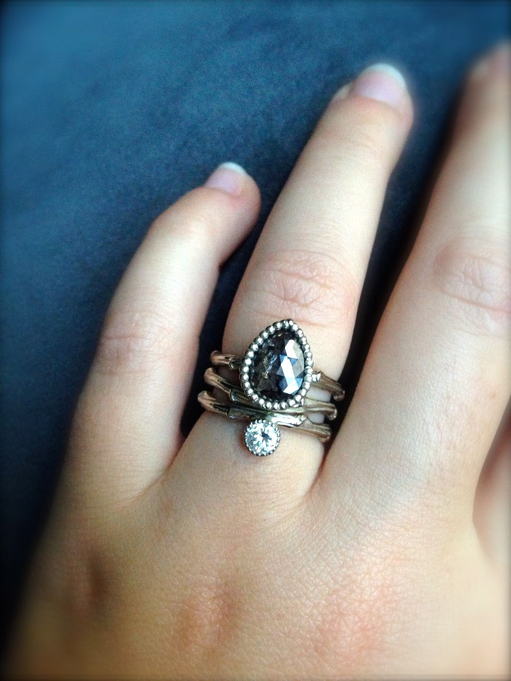 Jess wearing three of her Twig Rings stacked together.
