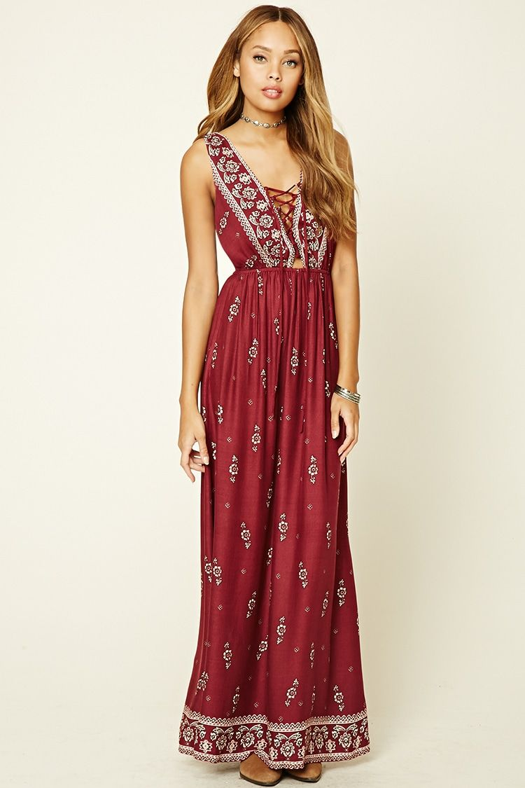A woven maxi dress featuring a floral print plunging laceup