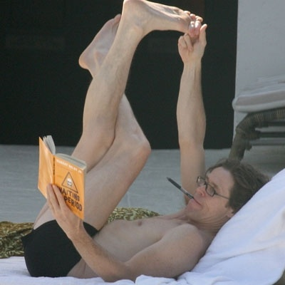 Willem Dafoe combines reading with yoga. For more book fun, go to www.facebook.com/booktasticfun