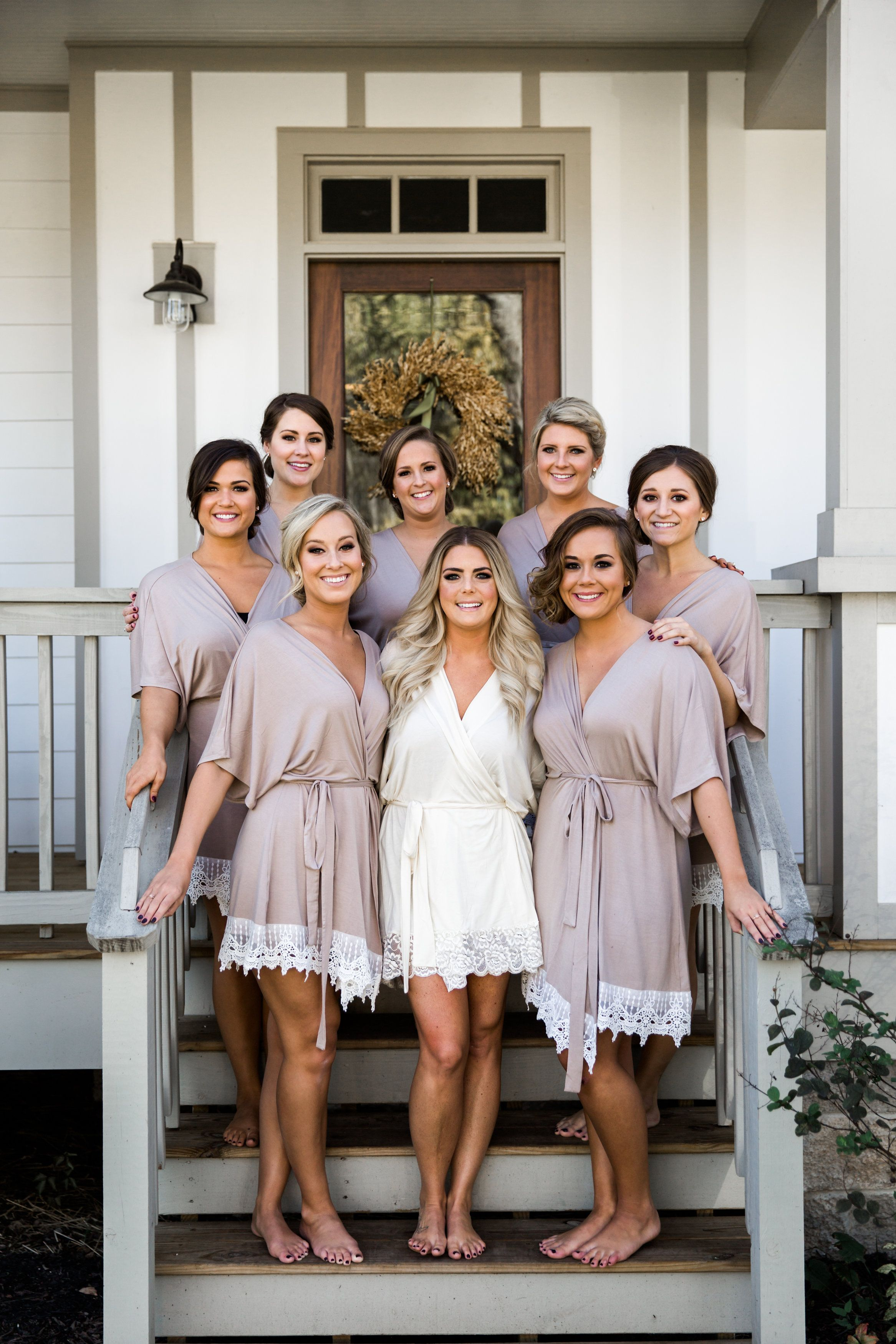 Bride and bridesmaids in matching robes getting ready for