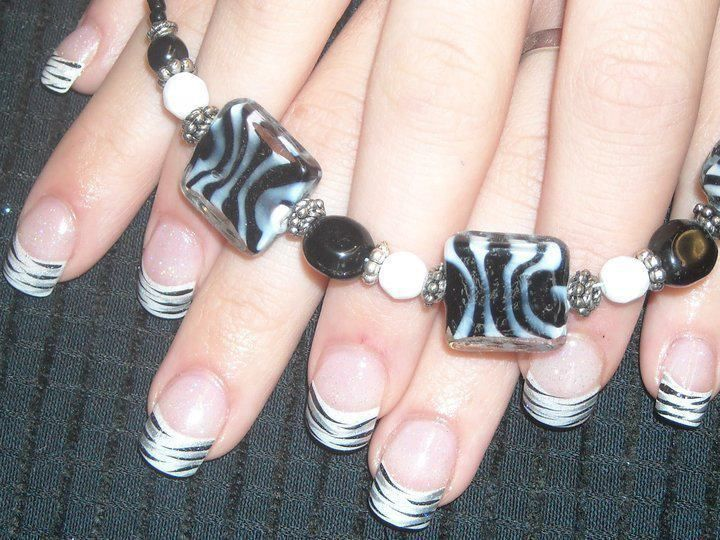 white and black striped nails