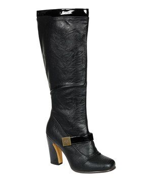 Be fashionably ready for cooler temps in this stylish boot, which features a chunky heel and chic side buckle detail.
