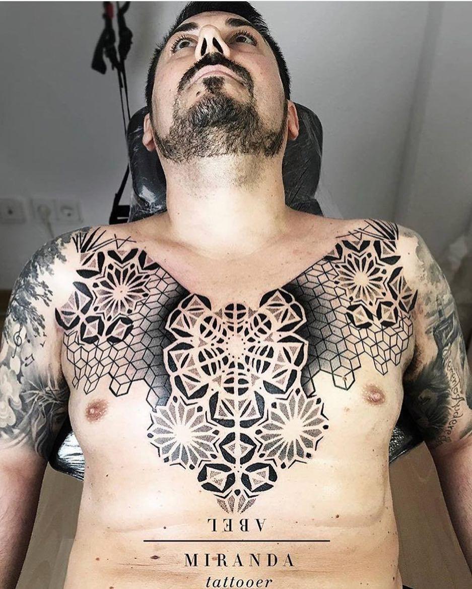 Geometric Mens Sternum Tattoo
