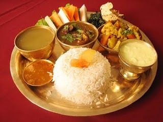Daal Bhat (pulses and rice), tarkari (vegetable) and aachar, (pickles)