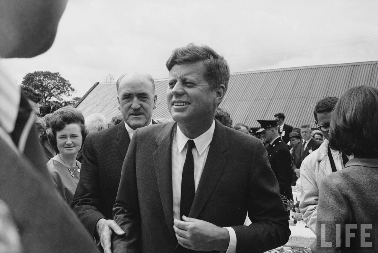 US President John F. Kennedy greeting people of his ancestral hometown upon his arrival during a visit to Ireland. Location: Dunganstown, Wexford, Ireland Date taken: 1963 Photographer: John Dominis