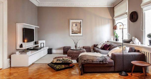 aranżacja salonu  z kawowymi ścianami, sofą i białymi meblami RTV
