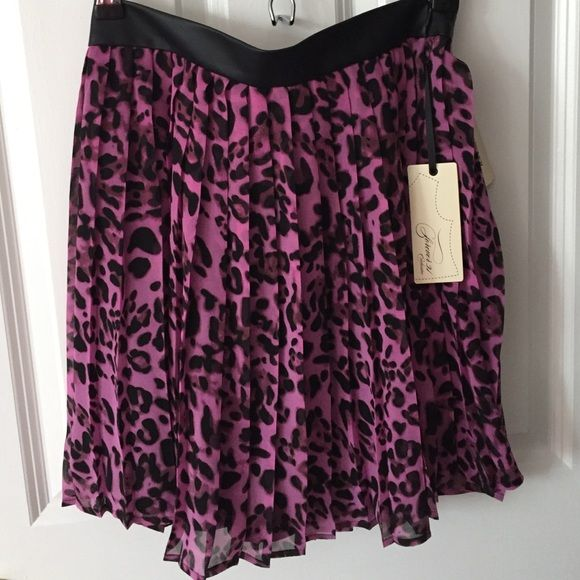 NWT fuchsia leopard print skater skirt NWT never worn fuchsia leopard print skater skirt, pleather black band and black lined fabric underneath flowy lightweight top Forever 21 Skirts Circle & Skater