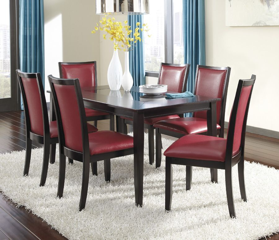 Regular height table pictured w/ red faux-leather chairs