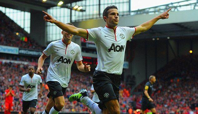 Flying away: Van Persie celebrates as Gerrard looks dejected at the final whistle