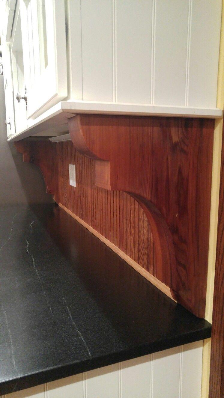 Western Cedar Corbels With Salvage Beadboard Backsplash And Soapstone