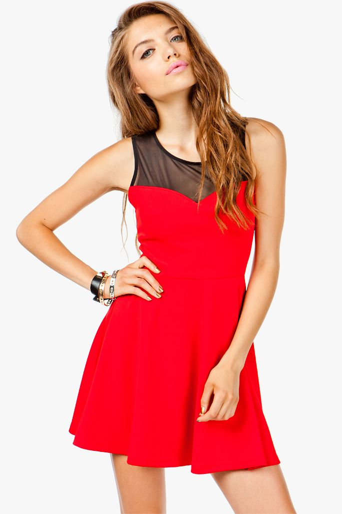Sweet and demure in silhouette but with a curve-hugging scuba body, this skater dress is like the best of both worlds! Cross strapped back with bow detail. Mesh inset. Sweetheart neckline.