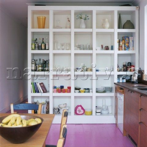 Kitchen With Large Wall Partition Storage Unit