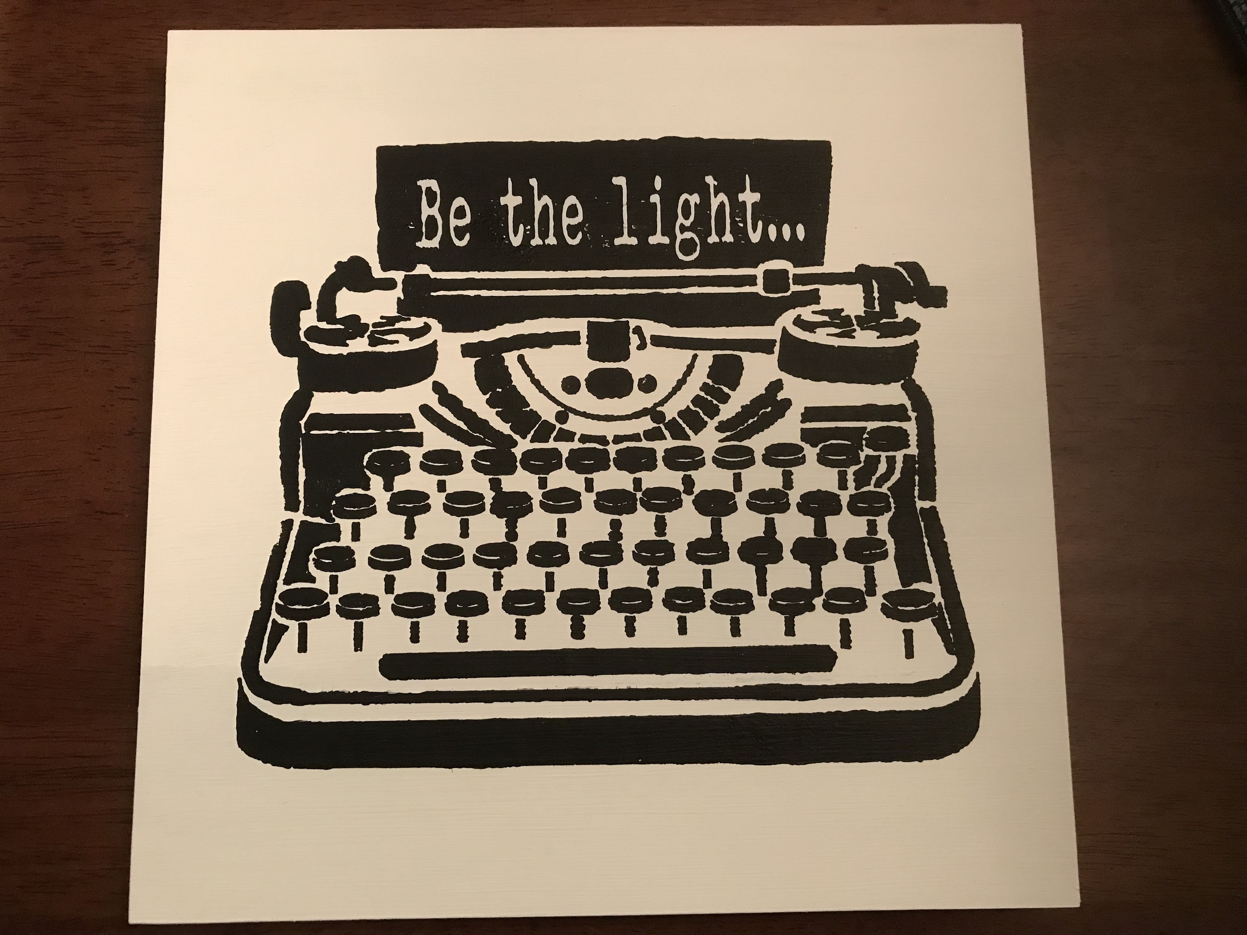 stenciled typewriter and vinyl letters wooden sign