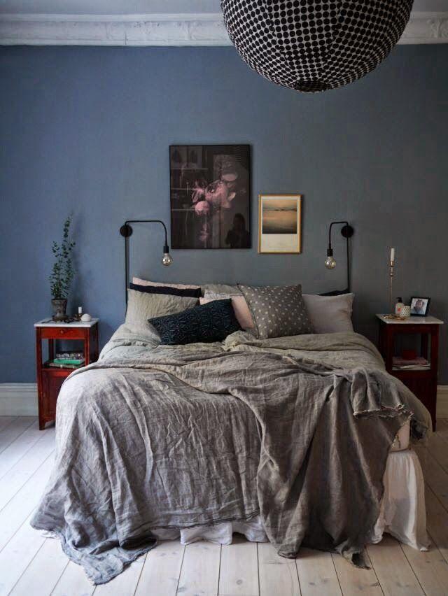 Bedroom Blue walls grey bedspread black spherical