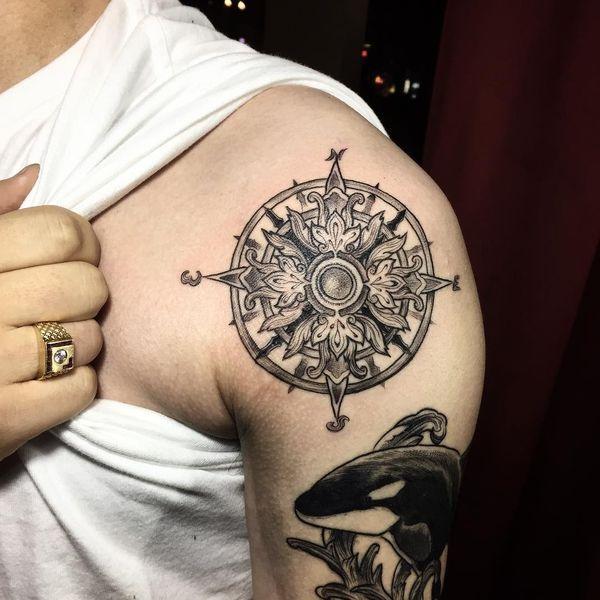 0ab8d4896fce8 Black ornamental compass tattoo on sleeve   tattoos   Compass tattoo ...