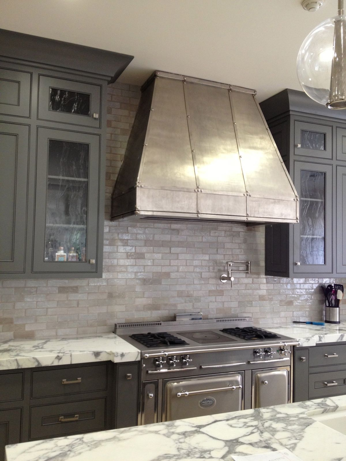 Loving the gray neutrals on the backsplash with the white and gray