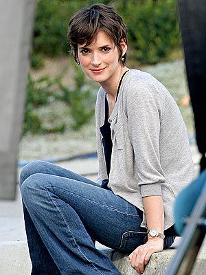 Soft boot-cut jeans and a slouchy cardigan is laid-back and relaxed without looking sloppy.