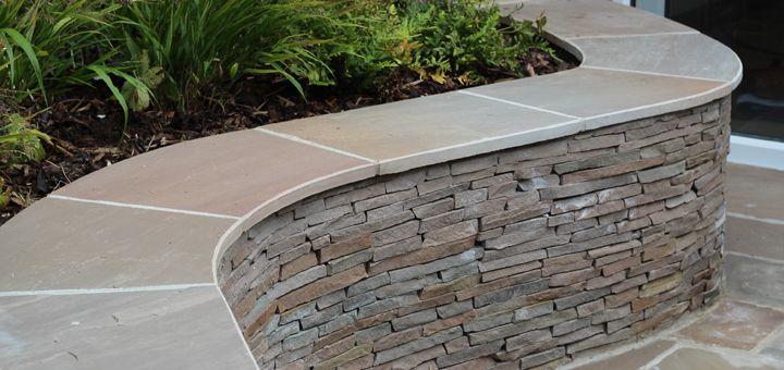 Curved Wall Garden Google Search Stone Walls Garden Garden Wall Front Garden Design