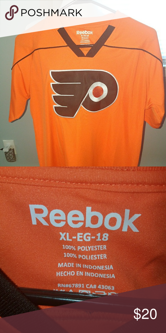 BNWOT Reebok Hockey Jersey Orange L  k New and well made with stiched on  logo on the front of the jersey. Size is XL Youth. Reebok Shirts   Tops cf85fe0f3