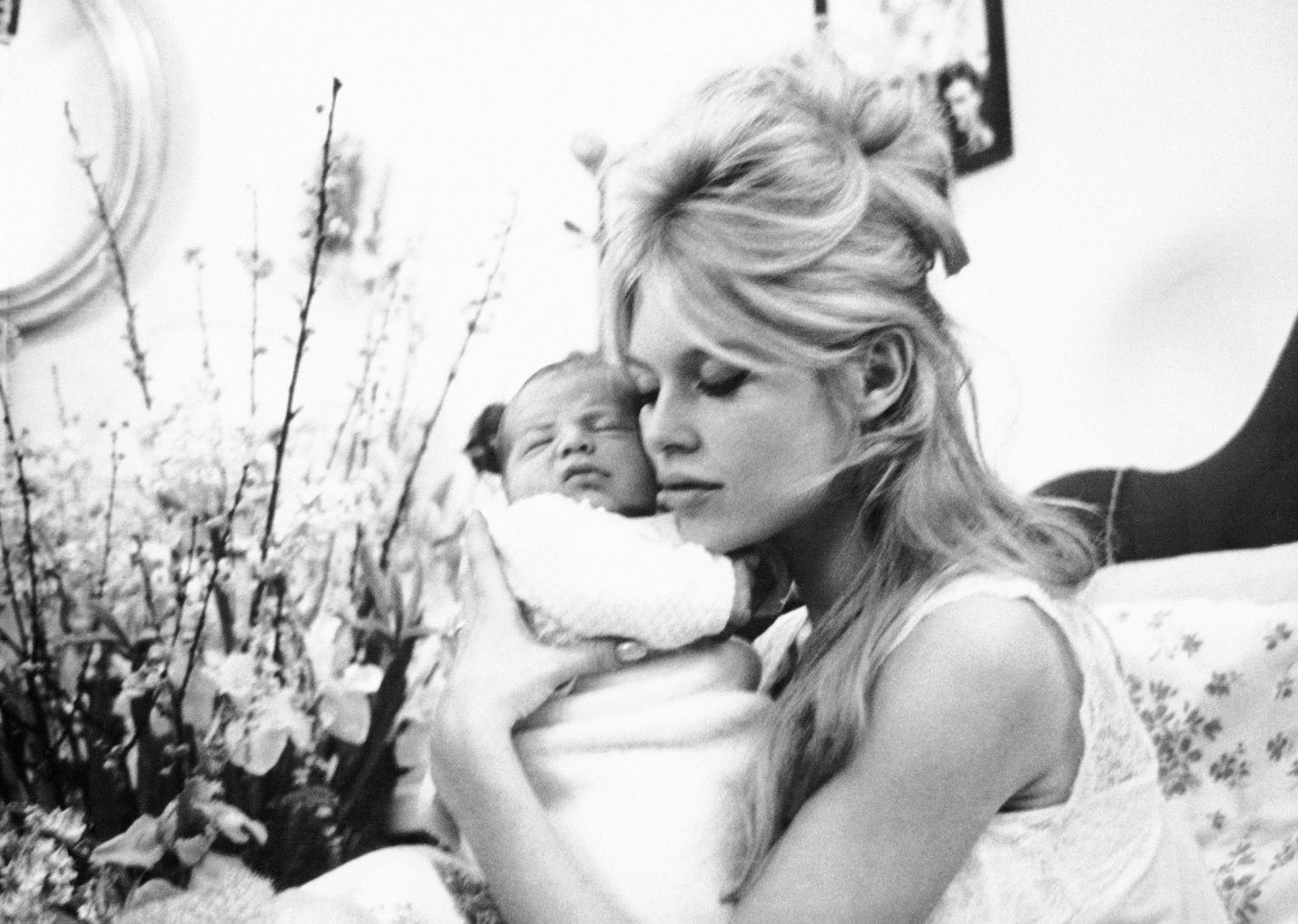 On 11 January 1960 Brigitte gave birth to her only child, Nicolas. Here she is cuddling him in her Paris apartment.