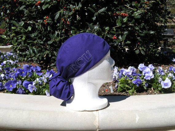 This custom embroidered TCU scrub cap is made with deep purple fabric and  black liner with