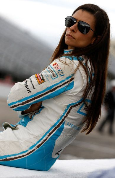 Danica Patrick Photos Photos - Danica Patrick, driver of the #10 Nature's Bakery Chevrolet, stands on the grid during qualifying for the NASCAR Sprint Cup Series Bad Boy Off Road 300 at New Hampshire Motor Speedway on September 23, 2016 in Loudon, New Hampshire. - New Hampshire Motor Speedway - Day 1