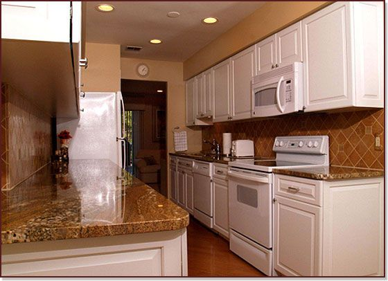 Custom Cabinet Renewal Meets A Galley Style Kitchen Transitional Styled Cabinets Of Maple Wood Galley Style Kitchen Kitchen Styling Refacing Kitchen Cabinets