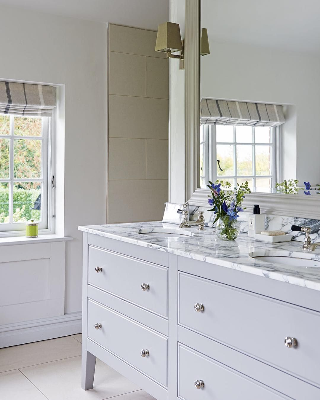 A large tailor-made mirror enhances the light in this beautiful ...