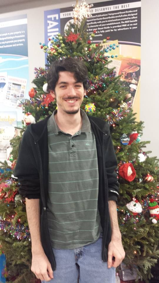 """When asked what his favorite activity during the holidays is this Southeast Publications employee - Brian Dean said """"I like to write poetry and play video games."""""""