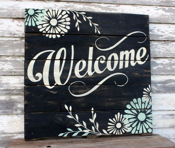 28 x 28 Welcome hand painted, repurposed pallet sign. Perfect for your front porch or entryway. Black with off white welcome. Flowers have pop of
