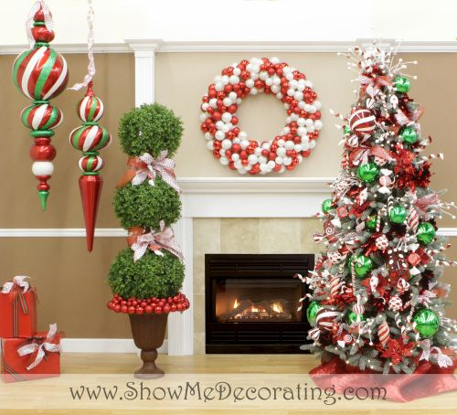 peppermint twist christmas tree theme by show me decorating add in a sweet twist to christmas