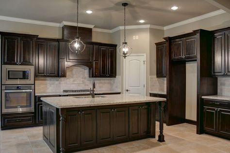 black walnut stained knotty alder cabinets. | kitchen ideas