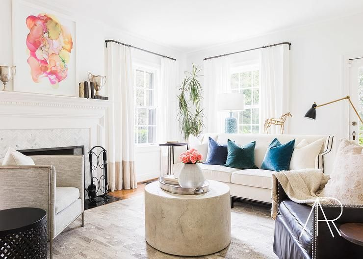 Julie Couch Interiors Chic living room features a white nailhead