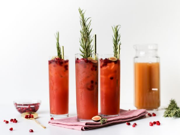 Muddled Pomegranate Cider Punch : A muddled cider punch will be the unexpected hit of your holiday party. Muddle pomegranate seeds and then mix with equal parts pomegranate juice and apple cider. Serve over ice with a tall rosemary sprig, more pomegranate seeds and a fig slice.