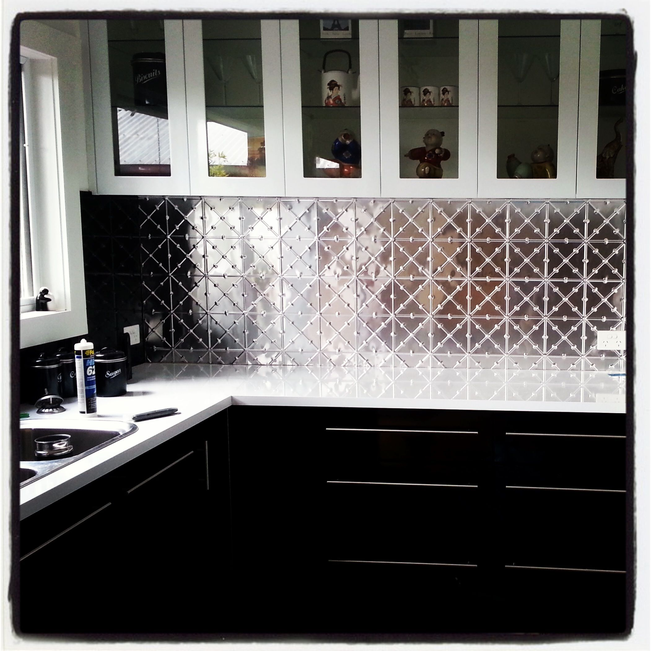 Industrial Rivet Pressed Metal splash back. Get the look with products from  Schots Home Emporium