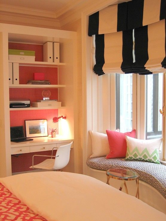 girl's room with built-in desk and bookshelves, window seat, black