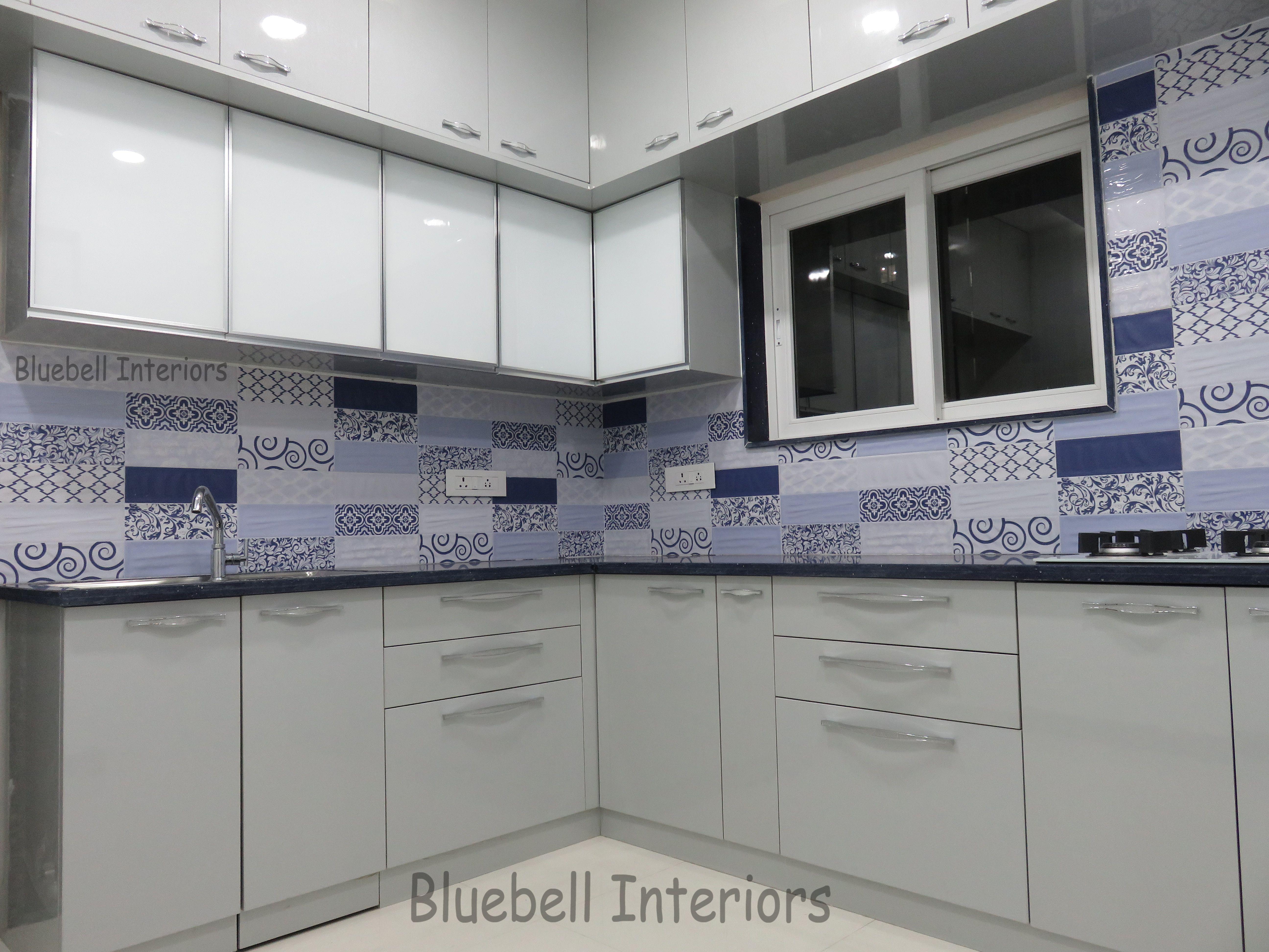 Grey Blue Modular Kitchen White Lacquered Glass Shutters Blue Dado Tiles Grey Acrylic Kitchen Modern Home Interior Design Kitchen Design House Interior
