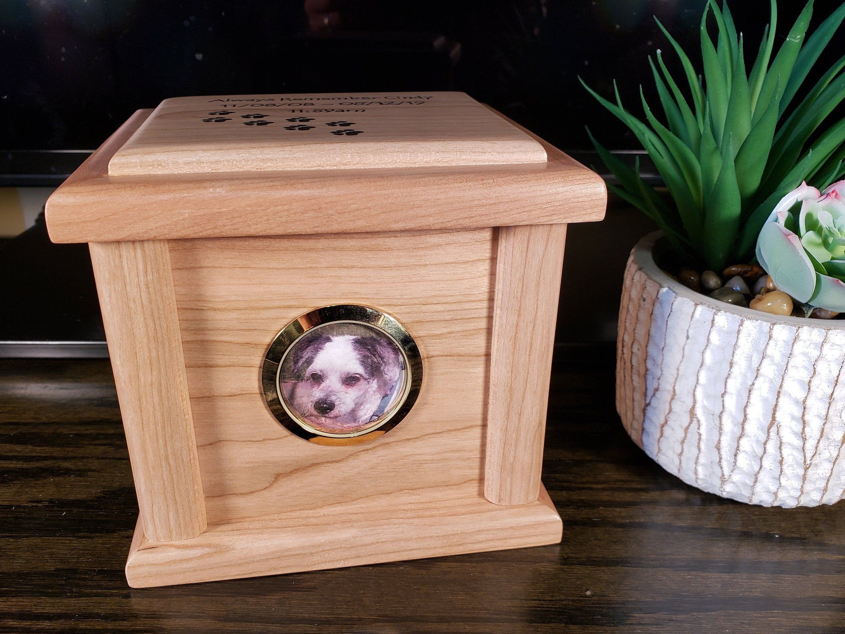 Pet cremation urn from solid wood styled like a pet
