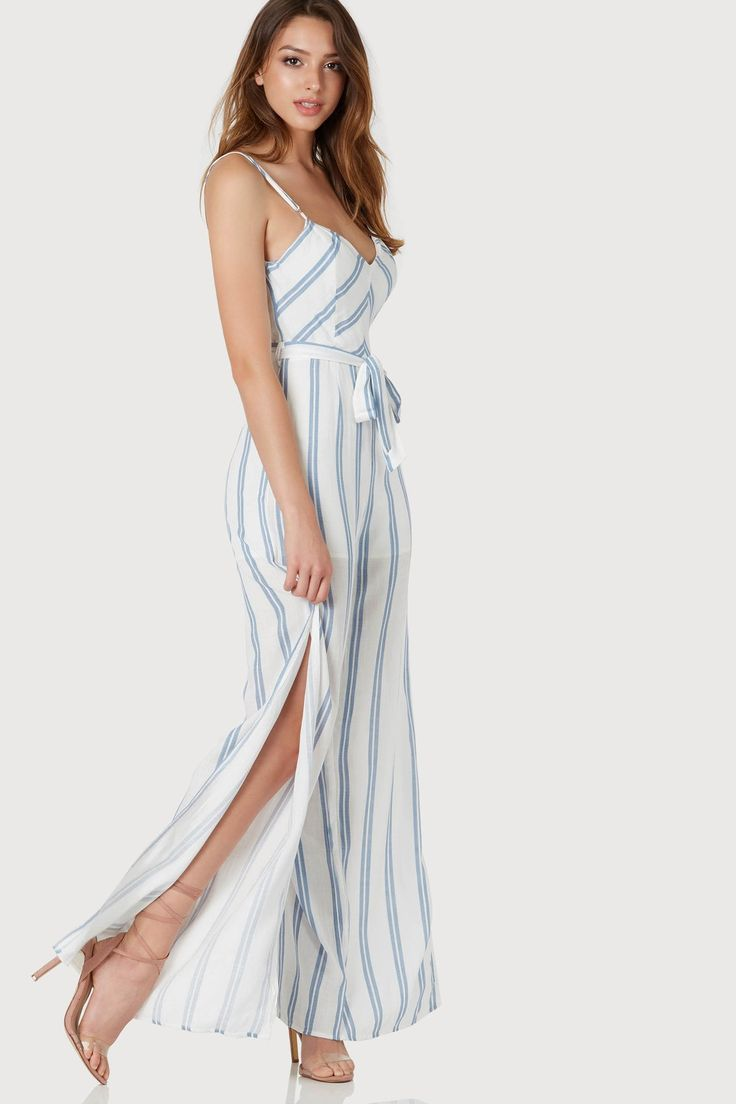 68e80bfe4a84 Sleeveless V-neck jumpsuit with stripe patterns throughout. Bold slits on  each side with hidden back zip closure.