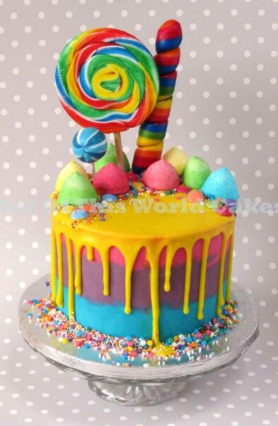 Drip Cake With Bright Rainbow Colours And Lots Of Sweets