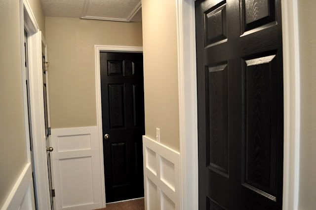 Nice Contrast With The Black Doors White Trim And Neutral Palette
