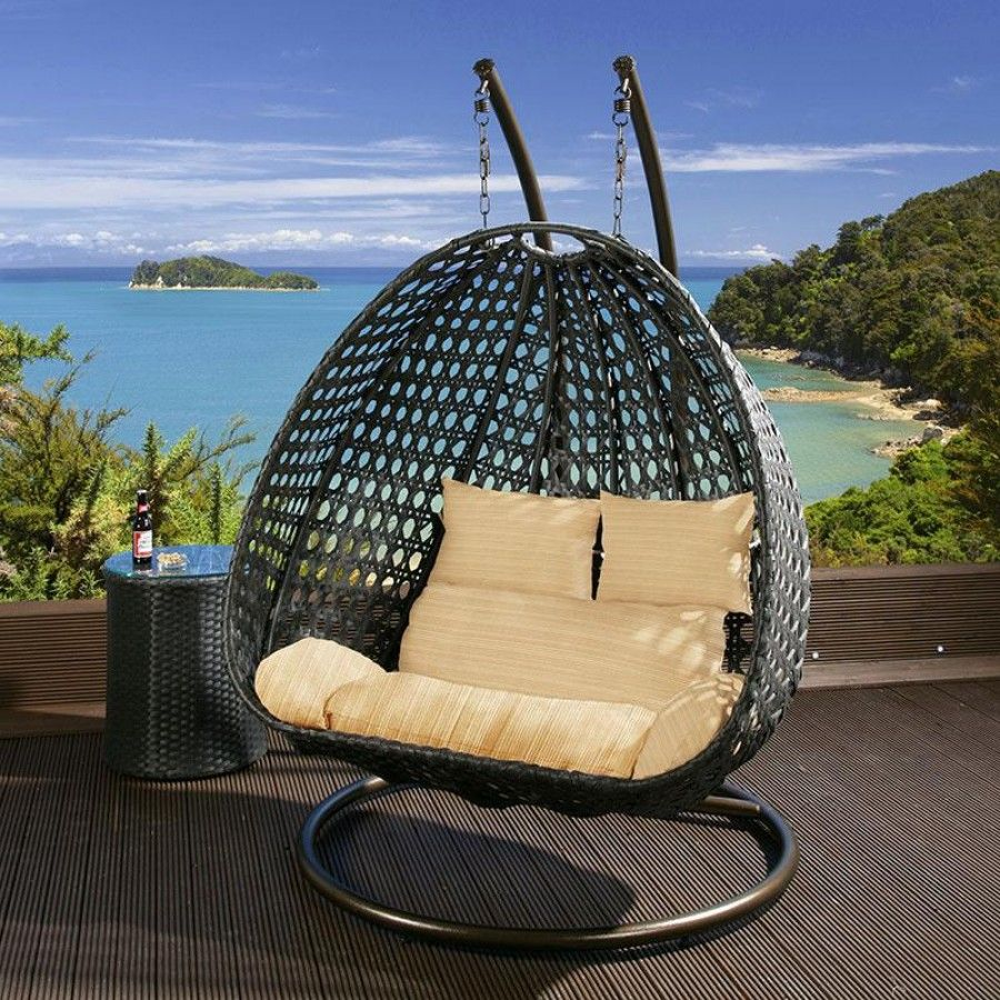 Black rattan two person hanging chair with beige cushion covers
