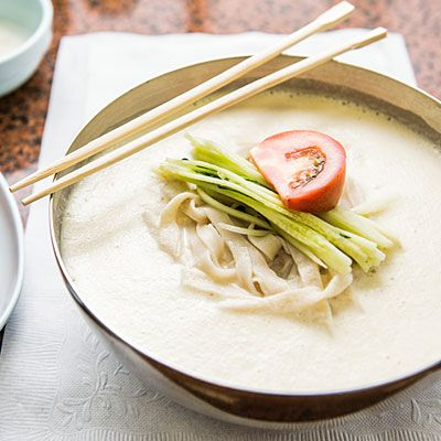 Guksu (soy milk noodle soup). Soups are considered a main dish in Korean cuisine, rather than a starter. This chilled noodle soup, garnished with cucumber and sliced tomatoes, is thick and creamy with a very mild flavor, but you can also punch up the taste with a bit of kimchi. When the noodles are made by hand, it's even better.