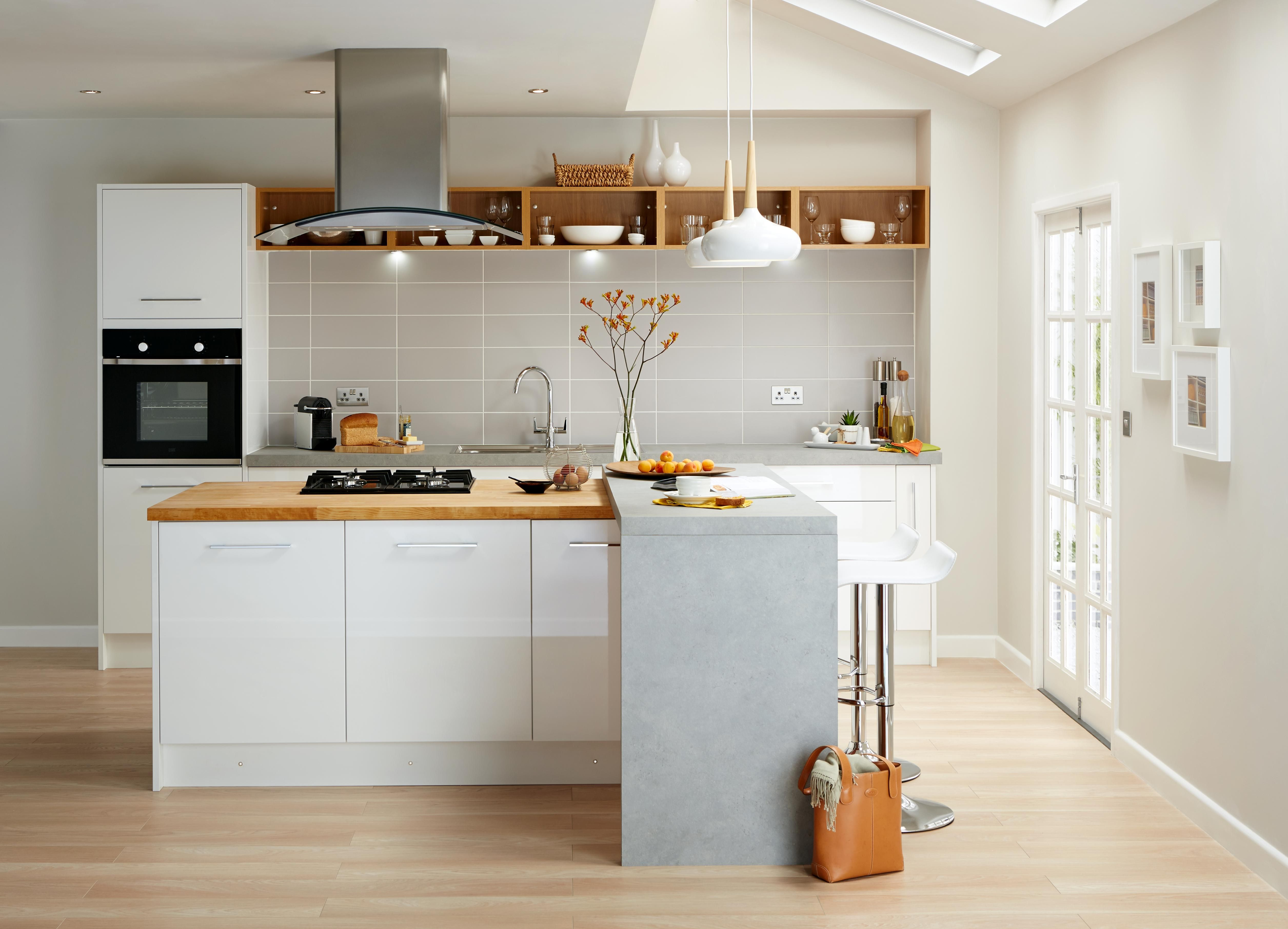 There's no denying it, white kitchens combined with wood