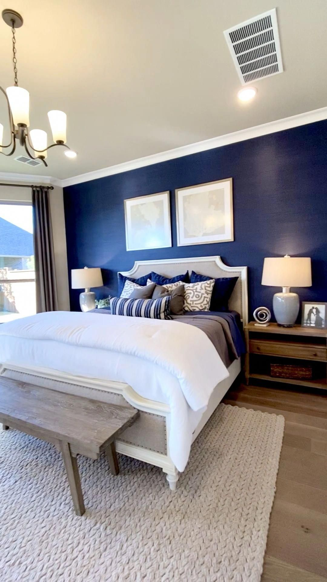 Master Bedroom Design With Royal Blue Accent Wall Behind The Bed