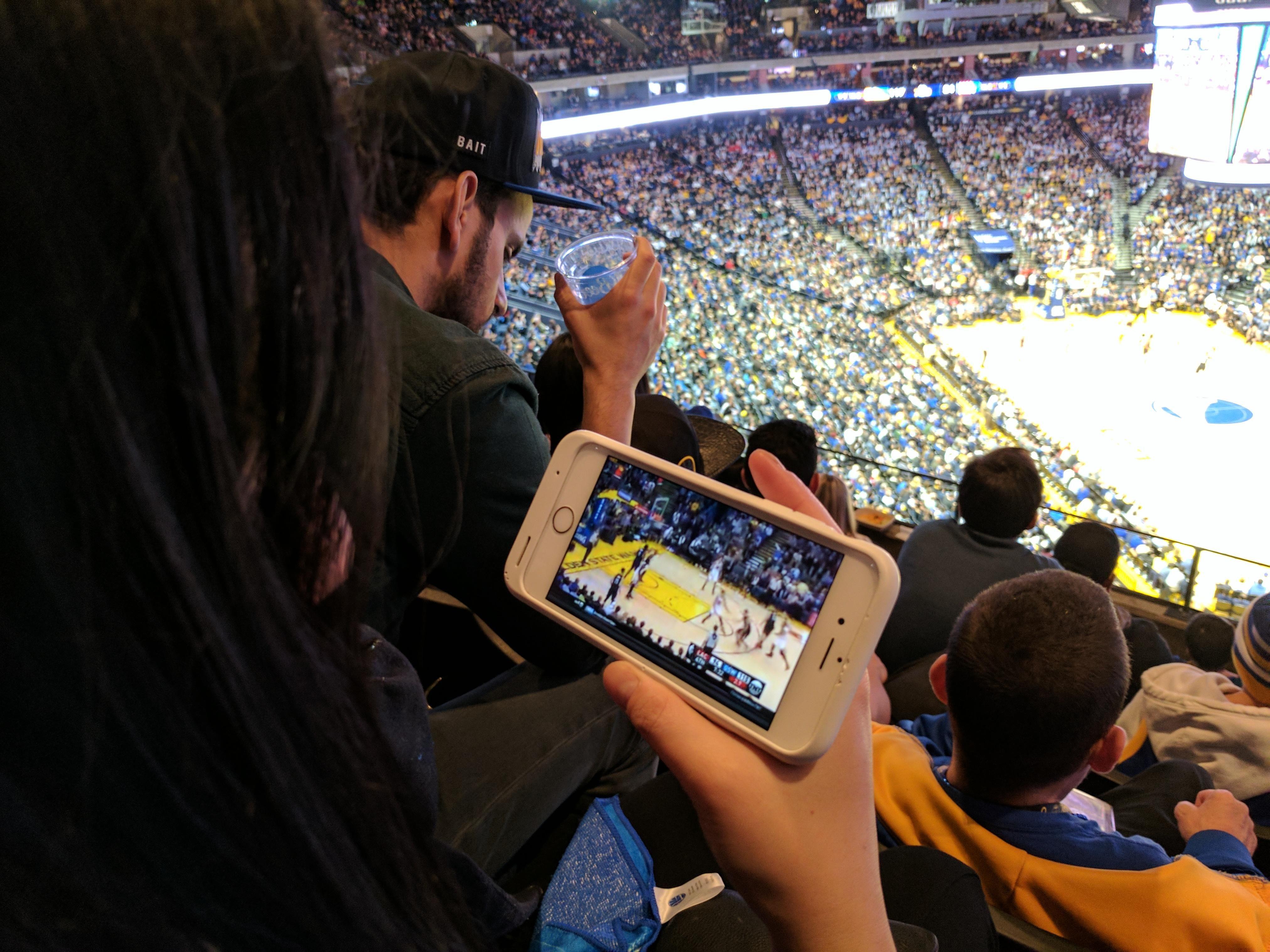My girlfriend enjoying her view at the Warriors game; worth $125.