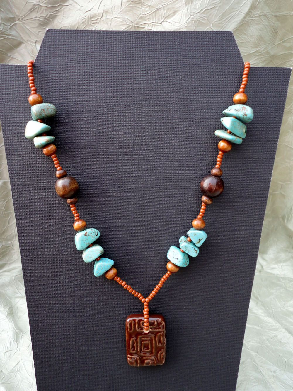 Ceramic pendant, magnesite and wood beads necklace. $15.00, via Etsy.